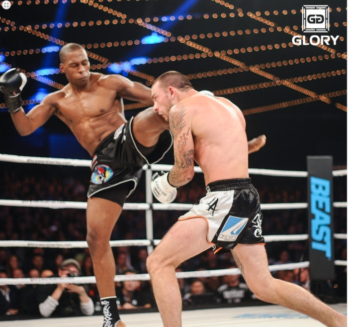 No kissing and hugging: Wayne Barrett (left) won the decision over 185 lb champ Joe Schilling at Glory 12.